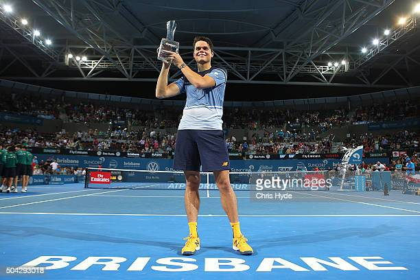 Milos Raonic of Canada holds the winners trophy after winning the Mens Final against Roger Federer of Switzerland during day eight of the 2016...
