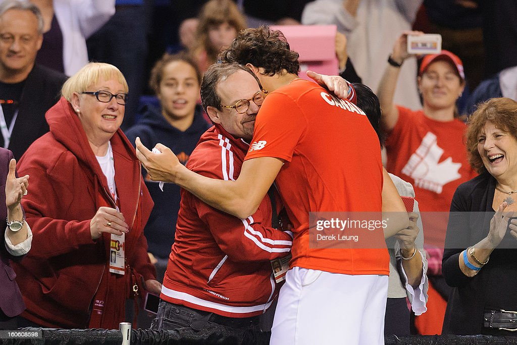 Milos Raonic of Canada hugs Tennis Canada President and CEO Michael S. Downey after defeating Guillermo Garcia-Lopez of Spain on day three of the 2013 Davis Cup on February 3, 2013 at UBC Thunderbird Arena in Vancouver, British Columbia, Canada.