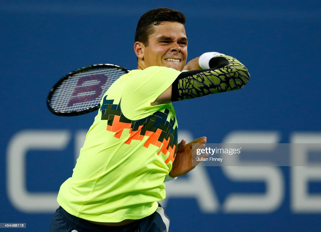 <a gi-track='captionPersonalityLinkClicked' href=/galleries/search?phrase=Milos+Raonic&family=editorial&specificpeople=5421226 ng-click='$event.stopPropagation()'>Milos Raonic</a> of Canada in action against Kei Nishikori of Japan on Day Eight of the 2014 US Open at the USTA Billie Jean King National Tennis Center on September 1, 2014 in the Flushing neighborhood of the Queens borough of New York City.