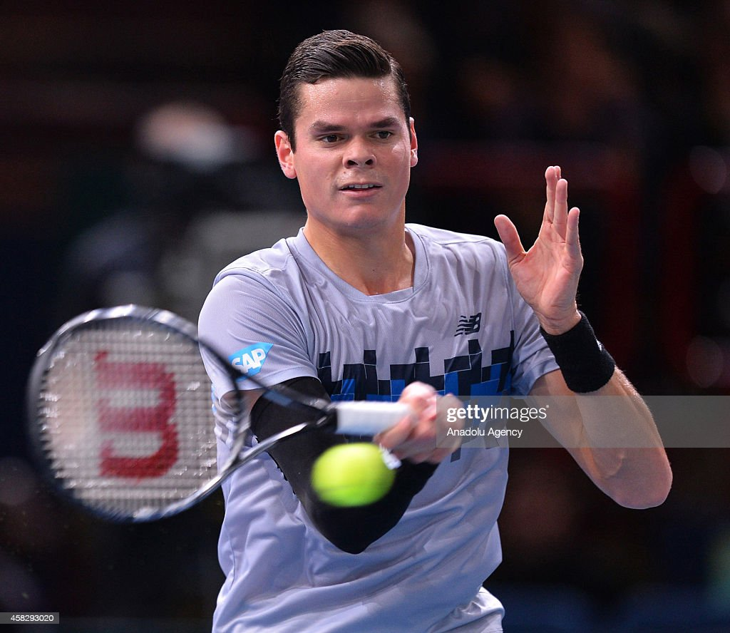 Milos Raonic of Canada in action against Novak Djokovic of Serbia in their Final match during day 7 of the BNP Paribas Masters held at the at Palais Omnisports de Bercy in Paris, France, on November 2, 2014.