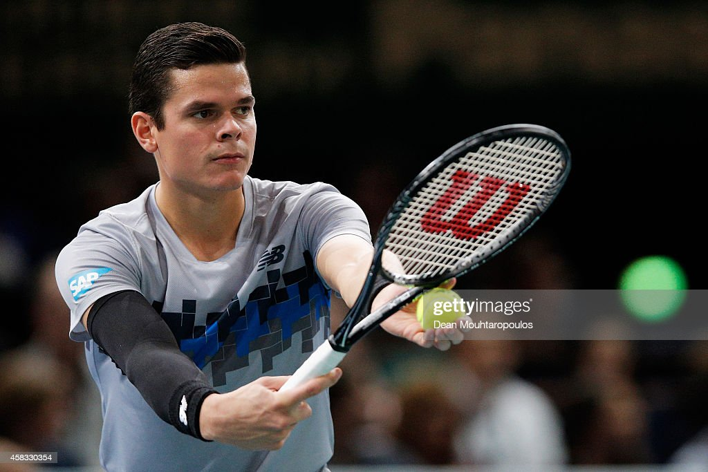 <a gi-track='captionPersonalityLinkClicked' href=/galleries/search?phrase=Milos+Raonic&family=editorial&specificpeople=5421226 ng-click='$event.stopPropagation()'>Milos Raonic</a> of Canada in action against Novak Djokovic of Serbia in their Final match during day 7 of the BNP Paribas Masters held at the at Palais Omnisports de Bercy on November 2, 2014 in Paris, France.