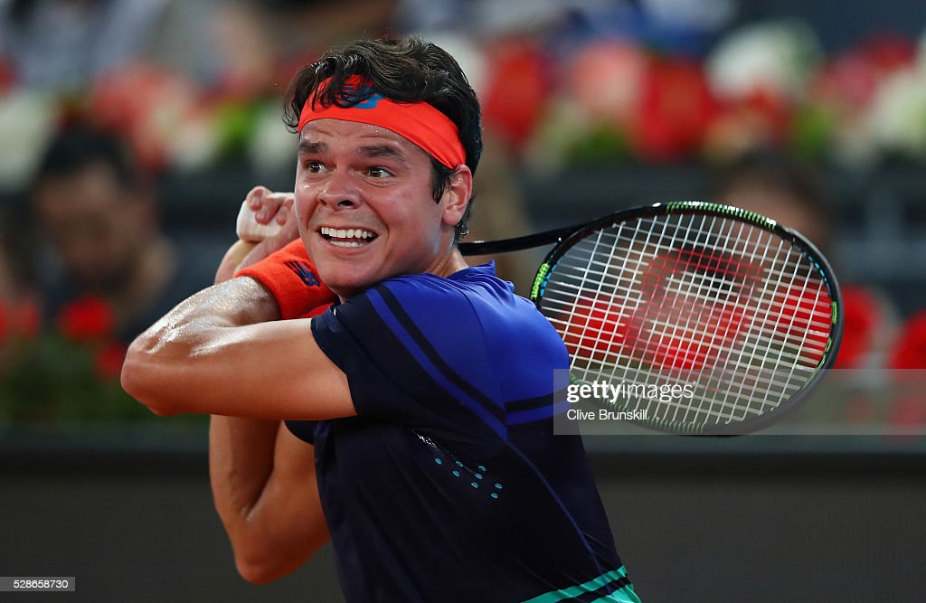 Milos Raonic of Canada in action against Novak Djokovic of Serbia in their quarter final round match during day seven of the Mutua Madrid Open tennis tournament at the Caja Magica on May 06, 2016 in Madrid,Spain.
