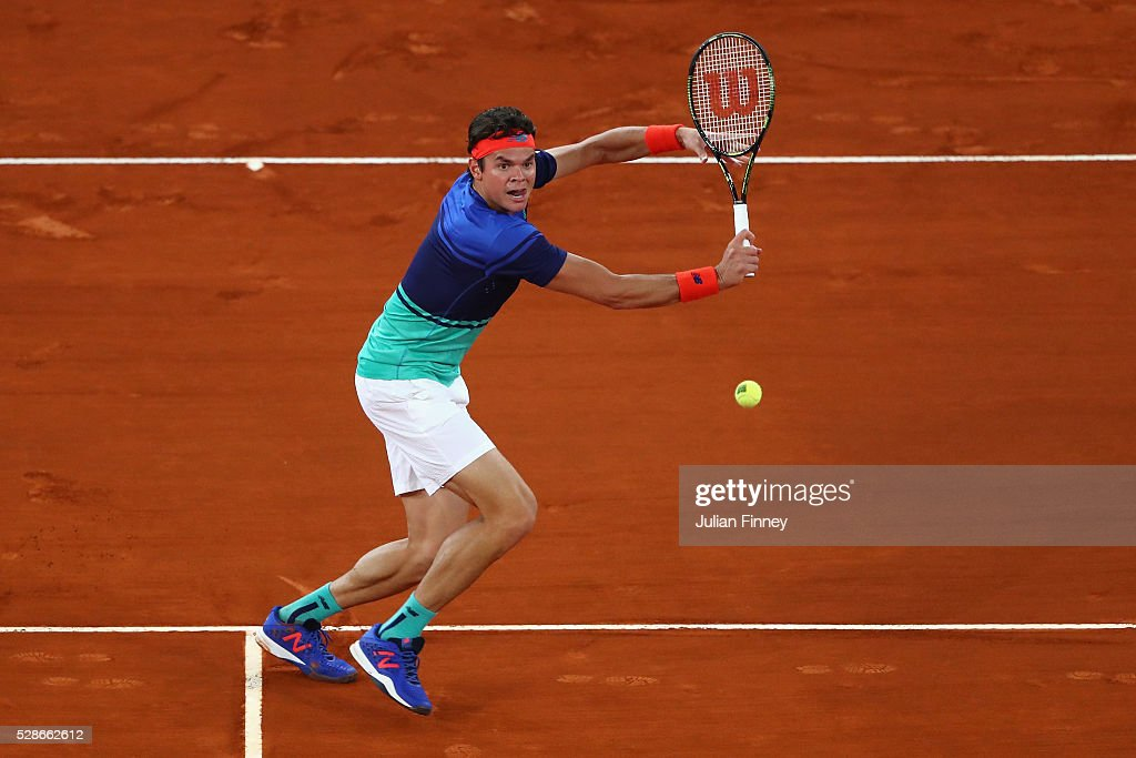 Milos Raonic of Canada in action against Novak Djokovic of Serbia during day seven of the Mutua Madrid Open tennis tournament at the Caja Magica on May 06, 2016 in Madrid, Spain.