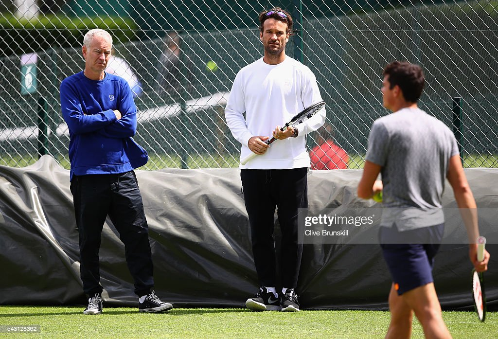 <a gi-track='captionPersonalityLinkClicked' href=/galleries/search?phrase=Milos+Raonic&family=editorial&specificpeople=5421226 ng-click='$event.stopPropagation()'>Milos Raonic</a> of Canada is watched by his coaches <a gi-track='captionPersonalityLinkClicked' href=/galleries/search?phrase=John+McEnroe&family=editorial&specificpeople=159411 ng-click='$event.stopPropagation()'>John McEnroe</a> and <a gi-track='captionPersonalityLinkClicked' href=/galleries/search?phrase=Carlos+Moya&family=editorial&specificpeople=171236 ng-click='$event.stopPropagation()'>Carlos Moya</a> during a practice session prior to the Wimbledon Lawn Tennis Championships at the All England Lawn Tennis and Croquet Club on June 26, 2016 in London, England.
