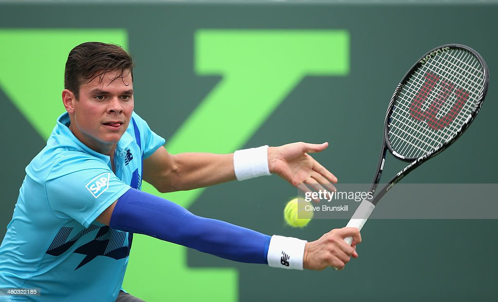 Milos Raonic of Canada plays a backhand against Guillermo Garcia-Lopez of Spain during their third round match during day 8 at the Sony Open at Crandon Park Tennis Center on March 24, 2014 in Key Biscayne, Florida.