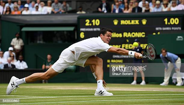 Milos Raonic of Canada plays a backhand during the Men's Singles Semi Final match against Roger Federer of Switzerland on day eleven of the Wimbledon...