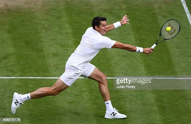 Milos Raonic of Canada plays a backhand during the Men's Singles third round match against Jack Sock of The United States on day six of the Wimbledon...