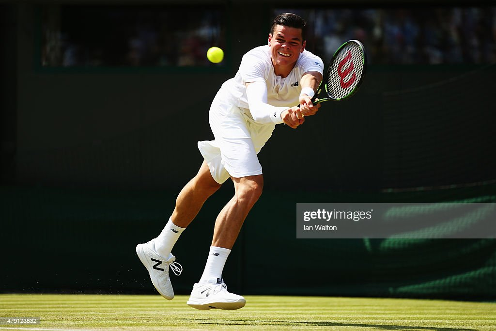 Milos Raonic of Canada plays a backhand in his Gentlemens Singles Second Round match against Tommy Haas of Germany during day three of the Wimbledon Lawn Tennis Championships at the All England Lawn Tennis and Croquet Club on July 1, 2015 in London, England.