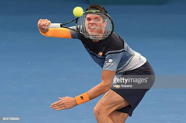 Milos Raonic of Canada plays a forehand against Ivan Dodig of Coratia during day five of the 2016 Brisbane International at Pat Rafter Arena on...
