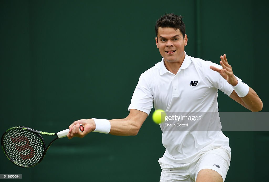 Milos Raonic of Canada plays a forehand during the Men's Singles second round match against Andreas Seppi of Italy on day four of the Wimbledon Lawn Tennis Championships at the All England Lawn Tennis and Croquet Club on June 30, 2016 in London, England.