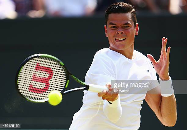 Milos Raonic of Canada plays a forehand in his Gentlemens Singles Second Round match against Tommy Haas of Germany during day three of the Wimbledon...
