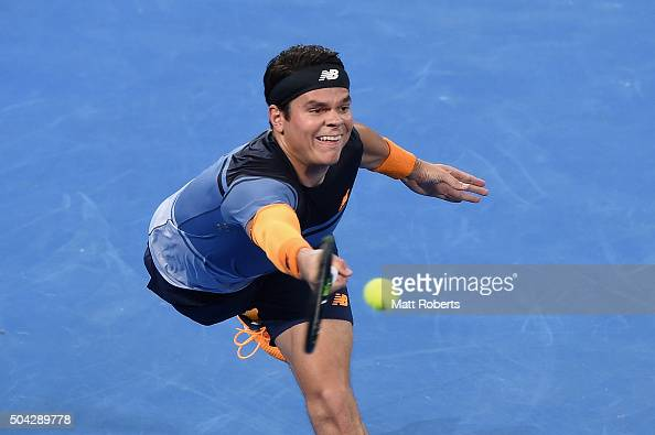 Milos Raonic of Canada plays a forehand in the Mens Final against Roger Federer of Switzerland during day eight of the 2016 Brisbane International at...