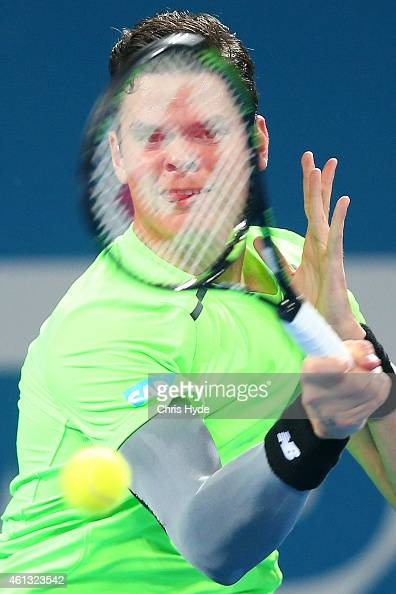 Milos Raonic of Canada plays a forehand in the Mens final match against Roger Federer of Switzerland during day eight of the 2015 Brisbane...