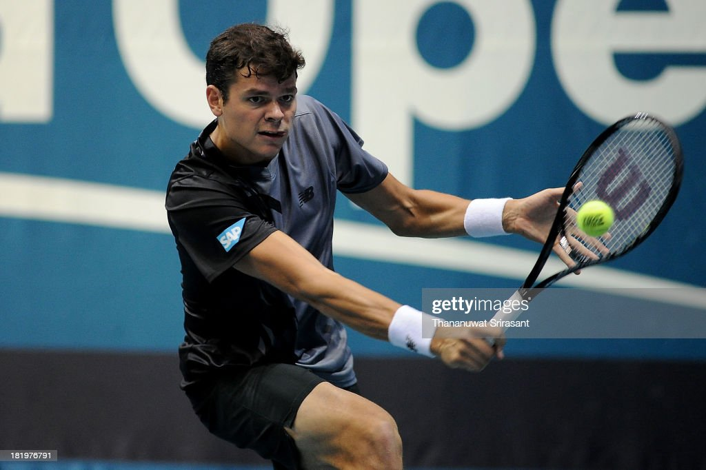 Milos Raonic of Canada plays a shot in his match against Marinko Matosevic of Australia during the 2013 Thailand Open at Impact Arena on September 26, 2013 in Bangkok, Thailand.