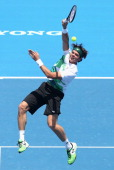 Milos Raonic of Canada plays a volley during his match against Lleyton Hewitt of Australia during day one of the AAMI Classic at Kooyong on January 9...