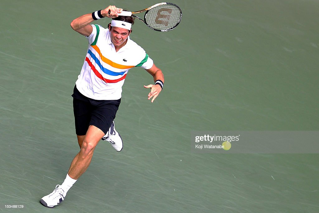 <a gi-track='captionPersonalityLinkClicked' href=/galleries/search?phrase=Milos+Raonic&family=editorial&specificpeople=5421226 ng-click='$event.stopPropagation()'>Milos Raonic</a> of Canada plays forehand in his match against Andy Murray of Great Britain during day six of the Rakuten Open at Ariake Colosseum on October 6, 2012 in Tokyo, Japan.