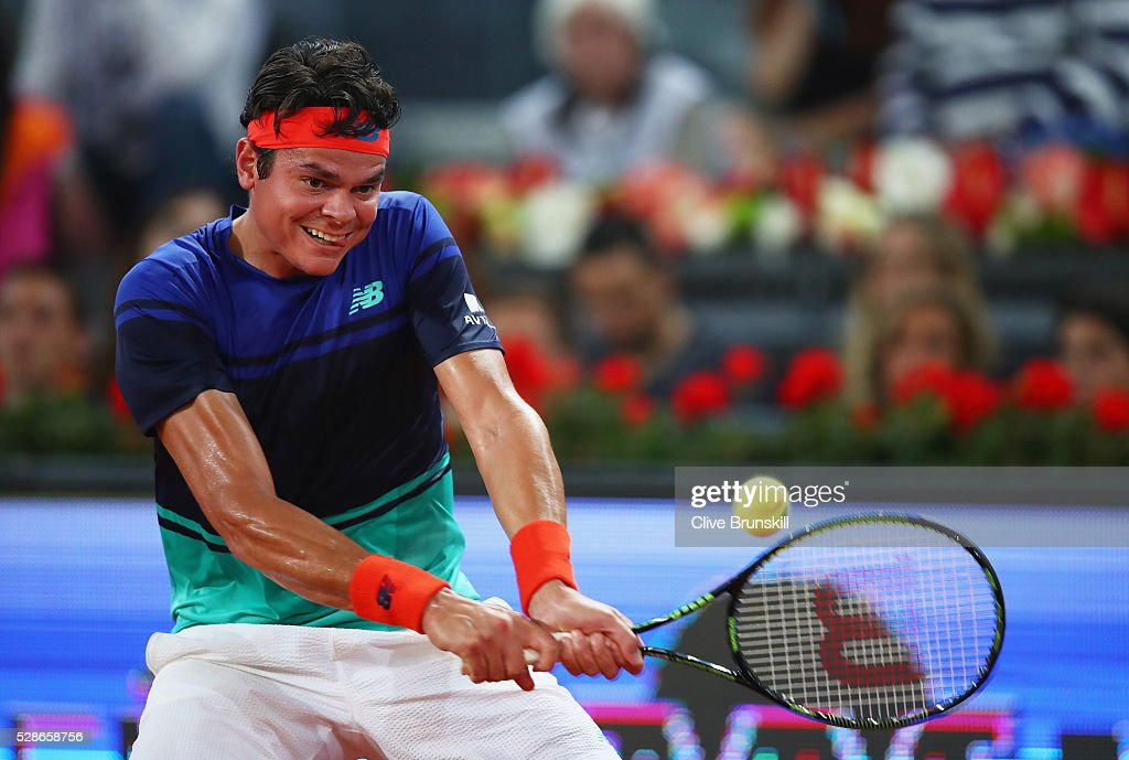 Milos Raonic of Canada plays s backhand against Novak Djokovic of Serbia in their quarter final round match during day seven of the Mutua Madrid Open tennis tournament at the Caja Magica on May 06, 2016 in Madrid,Spain.