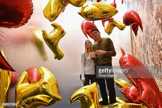 Milos Raonic of Canada poses with girlfriend Danielle Knudson in front of Ai Weiwei Bird Balloon exhibition at The National Gallery Victoria during...