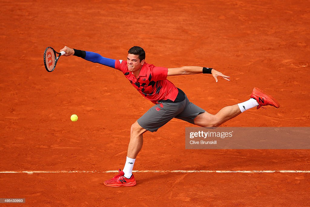 <a gi-track='captionPersonalityLinkClicked' href=/galleries/search?phrase=Milos+Raonic&family=editorial&specificpeople=5421226 ng-click='$event.stopPropagation()'>Milos Raonic</a> of Canada returns a shot during his men's singles quarter-final match against Novak Djokovic of Serbia on day ten of the French Open at Roland Garros on June 3, 2014 in Paris, France.