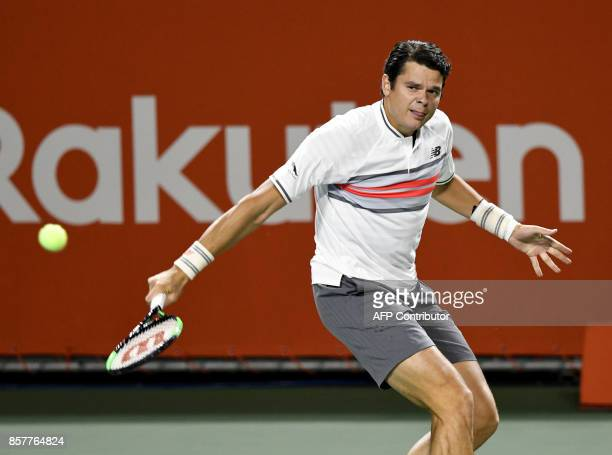 Milos Raonic of Canada returns a shot during his men's singles second round match against Yuichi Sugita of Japan at the Japan Open tennis tournament...