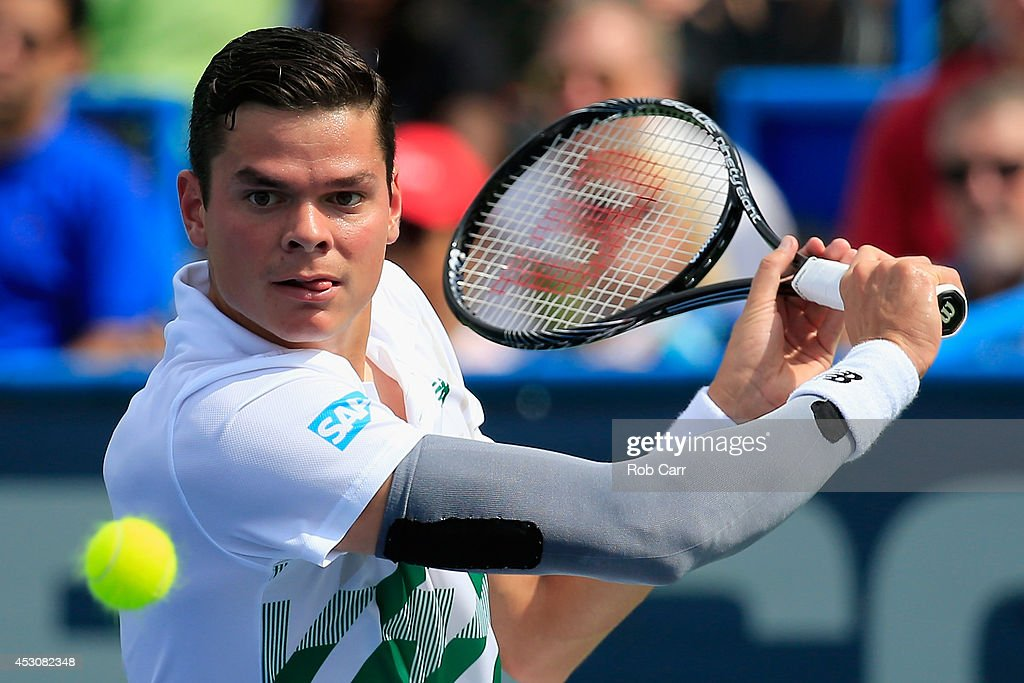 <a gi-track='captionPersonalityLinkClicked' href=/galleries/search?phrase=Milos+Raonic&family=editorial&specificpeople=5421226 ng-click='$event.stopPropagation()'>Milos Raonic</a> of Canada returns a shot to Donald Young of the United States during their seim-final match during the Citi Open at the William H.G. FitzGerald Tennis on August 2, 2014 in Washington, DC.