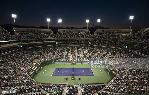 Milos Raonic of Canada returns a shot to Gael Monfils of France in the men's quarterfinals March 17 at the BNP Paribas Open at the Indian Wells...