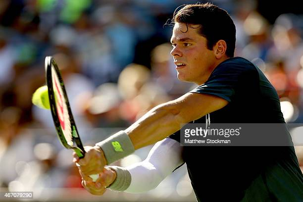 Milos Raonic of Canada returns a shot to Rafael Nadal of Spain during day twelve of the BNP Paribas Open at the Indian Wells Tennis Garden on March...