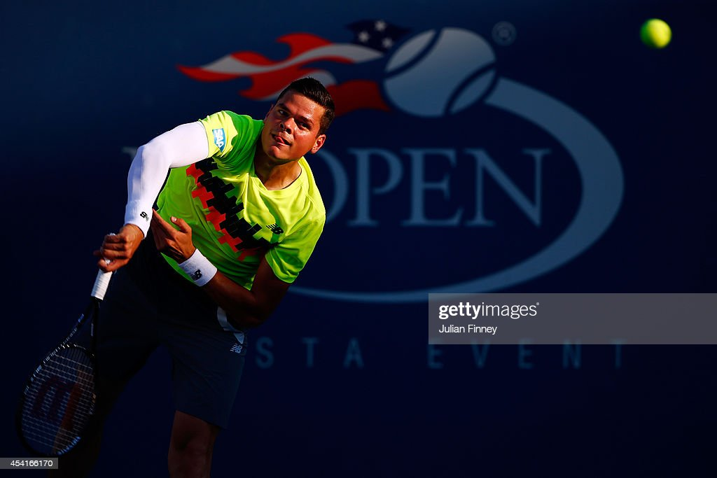 Milos Raonic of Canada returns a shot to Taro Daniel of Japan during his men's singles first round match on Day One of the 2014 US Open at the USTA Billie Jean King National Tennis Center on August 25, 2014 in the Flushing neighborhood of the Queens borough of New York City.
