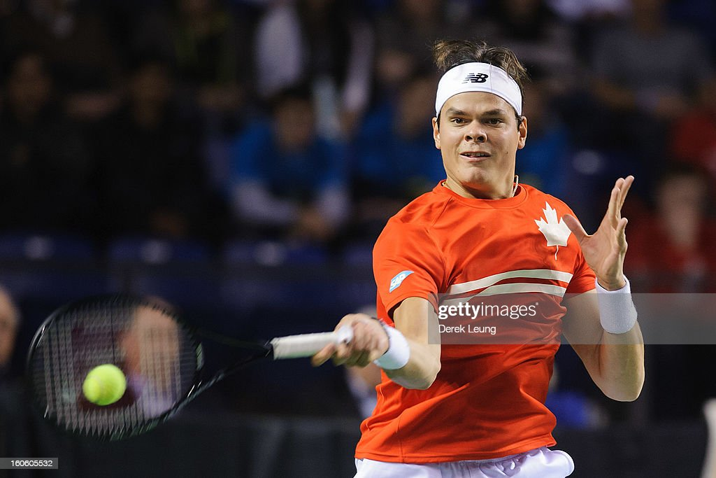 <a gi-track='captionPersonalityLinkClicked' href=/galleries/search?phrase=Milos+Raonic&family=editorial&specificpeople=5421226 ng-click='$event.stopPropagation()'>Milos Raonic</a> of Canada returns during his singles match against Guillermo Garcia-Lopez of Spain on day three of the 2013 Davis Cup on February 3, 2013 at UBC Thunderbird Arena in Vancouver, British Columbia, Canada.