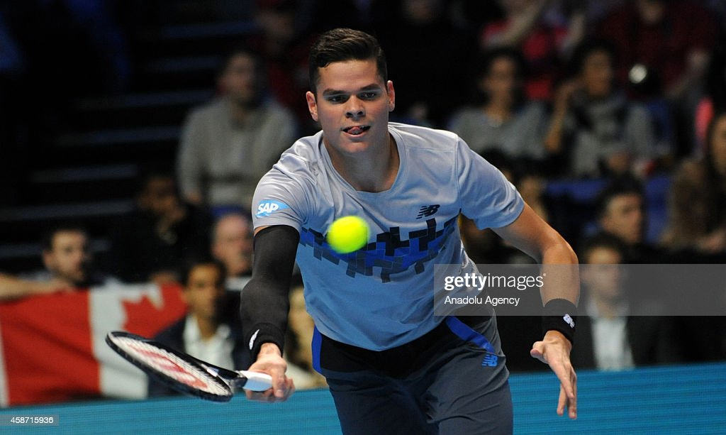 Milos Raonic of Canada returns the ball during his match against Roger Federer of Switzerland on day one of the Barclays ATP World Tour Finals tennis at O2 Arena on November 9, 2014 in London, England.