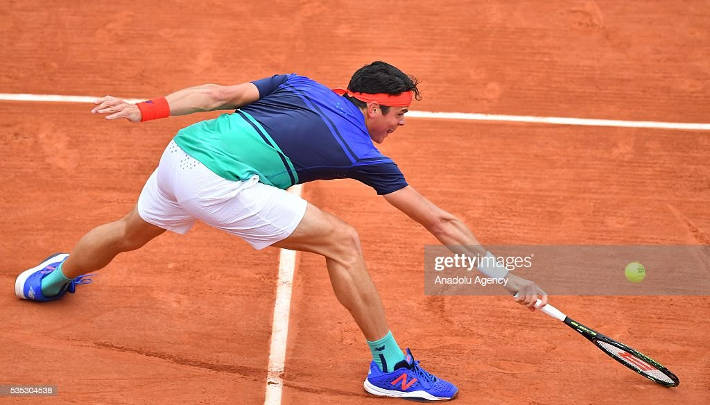 Milos Raonic of Canada returns to Albert Ramos-Vinolas (not seen) of Spain during the men's single fourth round match at the French Open tennis tournament at Roland Garros Stadium in Paris, France on May 29, 2016.