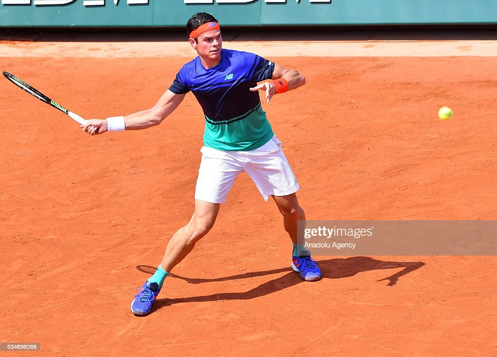 Milos Raonic of Canada returns to Andrej Martin (not seen) of Slovakia during the men's single third round match at the French Open tennis tournament at Roland Garros Stadium in Paris, France on May 27, 2016.