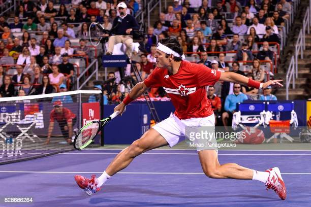 Milos Raonic of Canada rushes towards the net against Adrian Mannarino of France during day six of the Rogers Cup presented by National Bank at...
