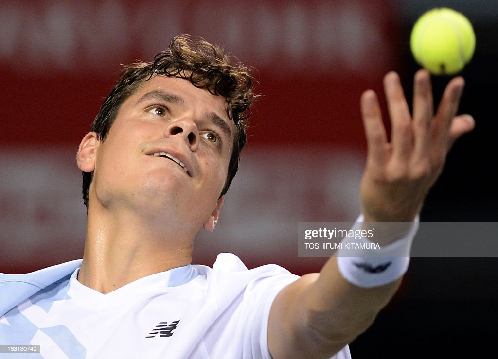 Milos Raonic of Canada serves against Ivan Dodig of Croatia during their men's singles semi-final match of the Japan Open tennis tournament in Tokyo on October 5, 2013.