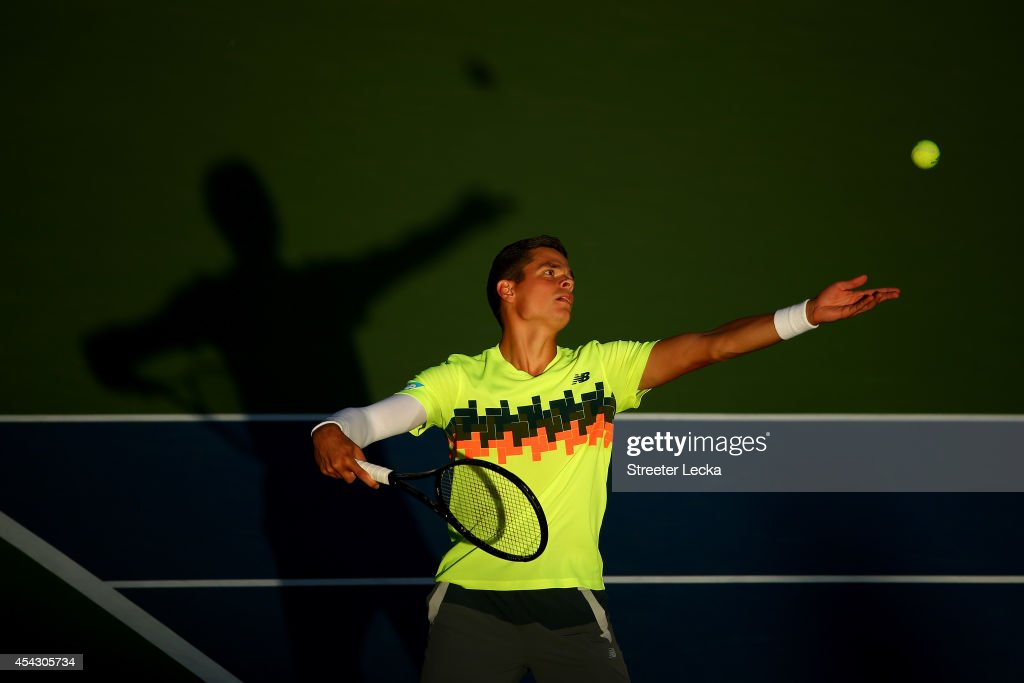 <a gi-track='captionPersonalityLinkClicked' href=/galleries/search?phrase=Milos+Raonic&family=editorial&specificpeople=5421226 ng-click='$event.stopPropagation()'>Milos Raonic</a> of Canada serves against Peter Gojowczyk of Germany on Day Four of the 2014 US Open at the USTA Billie Jean King National Tennis Center on August 28, 2014 in the Flushing neighborhood of the Queens borough of New York City.