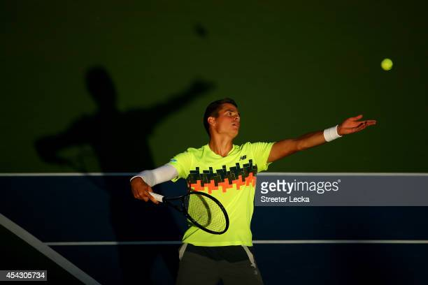 Milos Raonic of Canada serves against Peter Gojowczyk of Germany on Day Four of the 2014 US Open at the USTA Billie Jean King National Tennis Center...
