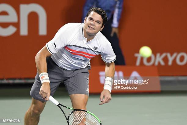 Milos Raonic of Canada serves during his men's singles second round match against Yuichi Sugita of Japan at the Japan Open tennis tournament in Tokyo...