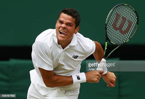 Milos Raonic of Canada serves during the Men's Singles Semi Final match against Roger Federer of Switzerland on day eleven of the Wimbledon Lawn...