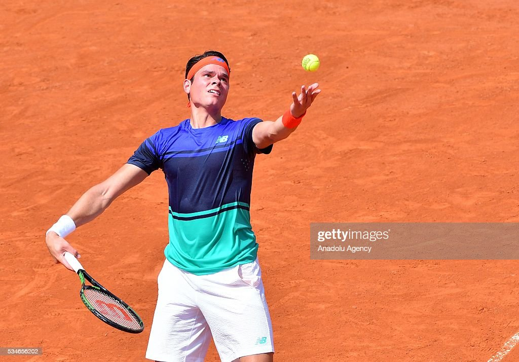 Milos Raonic of Canada serves to Andrej Martin (not seen) of Slovakia during the men's single third round match at the French Open tennis tournament at Roland Garros Stadium in Paris, France on May 27, 2016.