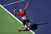 Milos Raonic of Canada serves to Inigo Cervantes of Spain during day six of the BNP Paribas Open at Indian Wells Tennis Garden on March 12 2016 in...