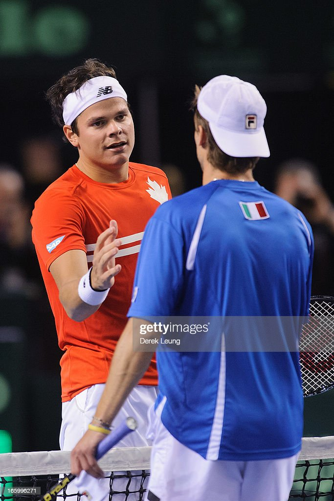 <a gi-track='captionPersonalityLinkClicked' href=/galleries/search?phrase=Milos+Raonic&family=editorial&specificpeople=5421226 ng-click='$event.stopPropagation()'>Milos Raonic</a> of Canada shakes hands with <a gi-track='captionPersonalityLinkClicked' href=/galleries/search?phrase=Andreas+Seppi&family=editorial&specificpeople=228727 ng-click='$event.stopPropagation()'>Andreas Seppi</a> of Italy after their singles match on day three of the 2013 Davis Cup quarterfinals on April 7, 2013 at Doug Mitchell Thunderbird Sports Centre in Vancouver, British Columbia, Canada. <a gi-track='captionPersonalityLinkClicked' href=/galleries/search?phrase=Milos+Raonic&family=editorial&specificpeople=5421226 ng-click='$event.stopPropagation()'>Milos Raonic</a> defeated <a gi-track='captionPersonalityLinkClicked' href=/galleries/search?phrase=Andreas+Seppi&family=editorial&specificpeople=228727 ng-click='$event.stopPropagation()'>Andreas Seppi</a> 3-1.