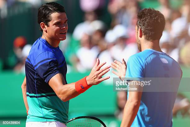 Milos Raonic of Canada shakes hands with Marco Cecchinato of Italy after his 6375 straight sets victory during day two of the Monte Carlo Rolex...