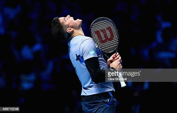 Milos Raonic of Canada shows his emotions against Roger Federer of Switzerland during their round robin match during the Barclays ATP World Tour...