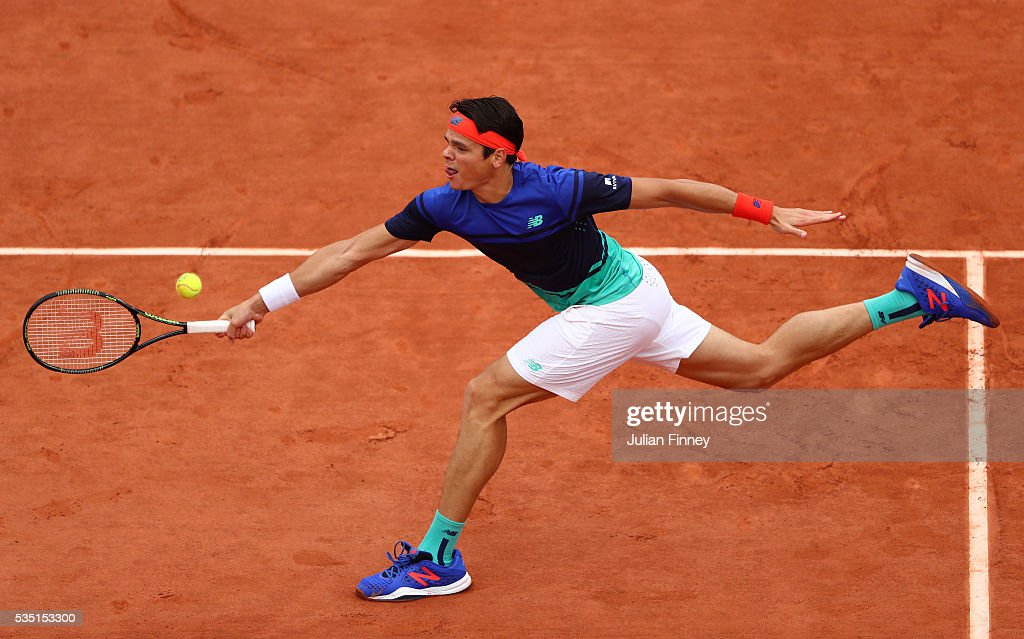 <a gi-track='captionPersonalityLinkClicked' href=/galleries/search?phrase=Milos+Raonic&family=editorial&specificpeople=5421226 ng-click='$event.stopPropagation()'>Milos Raonic</a> of Canada stretches to hit a forehand during the Men's Singles fourth round match against Alberto Ramos Vinolas of Spain on day eight of the 2016 French Open at Roland Garros on May 29, 2016 in Paris, France.