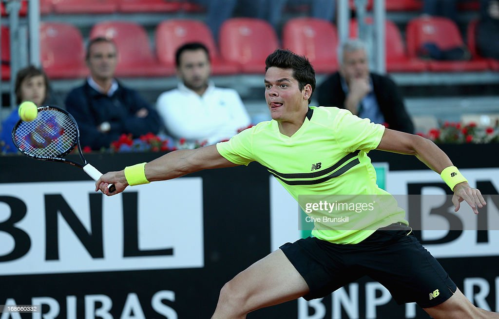 Milos Raonic of Canada stretches to play a forehand against Philipp Kohlschreiber of Germany in their first round match during day two of the Internazionali BNL d'Italia 2013 at the Foro Italico Tennis Centre on May 13, 2013 in Rome, Italy.