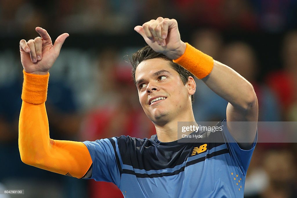 Milos Raonic of Canada the Mens Final against Roger Federer of Switzerland during day eight of the 2016 Brisbane International at Pat Rafter Arena on...