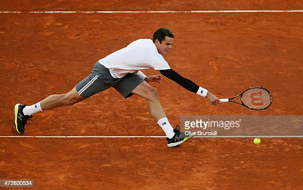 Milos Raonic of Canada volleys against Andy Murray of Great Britain in their quarter final match during day seven of the Mutua Madrid Open tennis...