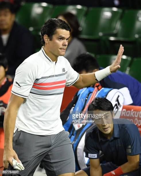 Milos Raonic of Canada waves to the fans after he retired with an injury during his men's singles second round match against Yuichi Sugita of Japan...
