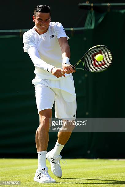 Milos Raonic of Cananda plays a backhand in his Gentlemen's Singles first round match against Daniel GimenoTraver of Spain during day one of the...