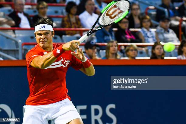 Milos Raonic returns the ball during his second round match at ATP Coupe Rogers on August 9 at Uniprix Stadium in Montreal QC